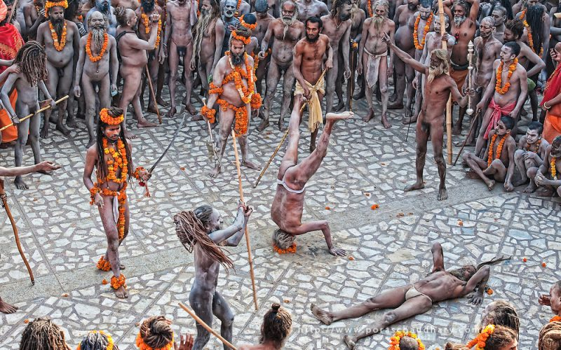Hundreds of Naga Sadhus gathered in the compound of Maya Devi Temple, befoe going in a procession to take a holy dip in the ganges.   Sadhus gather here and perform all kind of feats, to show off their warrior skills, with their weapons, which include sticks, tridents, swords and spears.  Kumbh Mela, 2010, Haridwar, Uttarakhand.